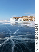 Купить «Lake Baikal in winter. Tourists travel on the ice and inspect the beautiful icy rocks of Olkhon Island on a sunny February day», фото № 29308925, снято 11 февраля 2018 г. (c) Виктория Катьянова / Фотобанк Лори