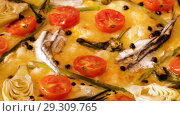 Купить «delicious pizza with anchovies, artichokes, cheese and sun-dried tomatoes on wooden background», видеоролик № 29309765, снято 19 сентября 2018 г. (c) Яков Филимонов / Фотобанк Лори