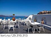 Купить «View of the Caldera from the terrace cafe, Fira, Santorini, Greece», фото № 29310313, снято 10 июня 2017 г. (c) Наталья Волкова / Фотобанк Лори