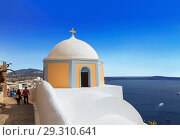 Купить «View of the city of Fira with greek Orthodox Church in the foreground, Santorini, Greece», фото № 29310641, снято 7 июня 2017 г. (c) Наталья Волкова / Фотобанк Лори