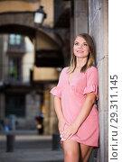 Купить «Young smiling woman near the stone wall in historical center», фото № 29311145, снято 26 июня 2019 г. (c) Яков Филимонов / Фотобанк Лори