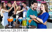 Купить «Young attractive women with men are dancing in pairs in the nightclub», фото № 29311469, снято 2 августа 2017 г. (c) Яков Филимонов / Фотобанк Лори