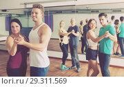Купить «Ordinary adults dancing bachata», фото № 29311569, снято 15 ноября 2018 г. (c) Яков Филимонов / Фотобанк Лори