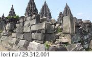Купить «Candi Prambanan or Candi Rara Jonggrang is an 9th-century Hindu temple compound in Central Java, Indonesia», видеоролик № 29312001, снято 11 октября 2008 г. (c) Куликов Константин / Фотобанк Лори