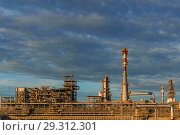 Industrial landscape - oil refinery with pipelines, distillers and chimneys. Стоковое фото, фотограф Евгений Харитонов / Фотобанк Лори