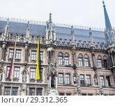 Купить «Fragment of New Town Hall of Munich (Neues Rathaus) neo-Gothic style palace in Marienplatz, the town square in historic center. Germany, Europe», фото № 29312365, снято 27 января 2018 г. (c) Николай Коржов / Фотобанк Лори