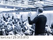 Купить «Sturtup expert giving talk at business event workshop.», фото № 29313813, снято 16 ноября 2018 г. (c) Matej Kastelic / Фотобанк Лори
