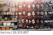 Купить «Blurred selection of products shelves in grocery store», фото № 29315857, снято 21 октября 2018 г. (c) Pavel Biryukov / Фотобанк Лори