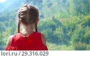 Купить «Adorable happy little girl in the cabin on the cable car in mountains in the background of beautful landscape», видеоролик № 29316029, снято 17 октября 2018 г. (c) Дмитрий Травников / Фотобанк Лори