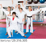Купить «Happy kids karate group with coach», фото № 29316305, снято 6 августа 2018 г. (c) Яков Филимонов / Фотобанк Лори