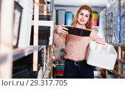 Купить «Woman choosing different plastic basket for storage in household shop», фото № 29317705, снято 15 января 2018 г. (c) Яков Филимонов / Фотобанк Лори