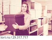 Купить «Young woman choosing soft pouf in modern home furnishings store», фото № 29317717, снято 15 января 2018 г. (c) Яков Филимонов / Фотобанк Лори