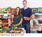 Купить «spouses with children near shelves with fruits», фото № 29317761, снято 23 июня 2018 г. (c) Яков Филимонов / Фотобанк Лори
