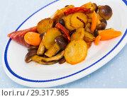 Купить «Pan-fried potatoes with mushrooms and chorizo», фото № 29317985, снято 11 декабря 2018 г. (c) Яков Филимонов / Фотобанк Лори