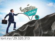 Купить «Businessman pushing wheelbarrow uphill in debt loan concept», фото № 29320313, снято 22 ноября 2018 г. (c) Elnur / Фотобанк Лори