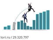 Купить «Businessman outperforming his competition jumping over», фото № 29320797, снято 16 ноября 2018 г. (c) Elnur / Фотобанк Лори