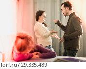 Купить «Young mother and father arguing with each other», фото № 29335489, снято 18 января 2019 г. (c) Яков Филимонов / Фотобанк Лори