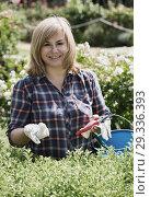 Купить «woman garden tool», фото № 29336393, снято 17 июня 2016 г. (c) Яков Филимонов / Фотобанк Лори