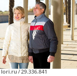 Купить «Married couple goes for walk between concrete pillars», фото № 29336841, снято 8 июля 2020 г. (c) Яков Филимонов / Фотобанк Лори