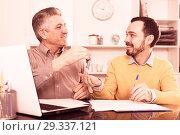 Купить «Mature man and agent sign rental agreement», фото № 29337121, снято 22 января 2019 г. (c) Яков Филимонов / Фотобанк Лори