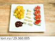 Купить «Cheese plate with grapes and figs. Wine snaks.», фото № 29360005, снято 22 ноября 2019 г. (c) Игорь Бородин / Фотобанк Лори