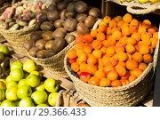 Купить «appetizing apricots in wicker baskets on counter in market», фото № 29366433, снято 26 мая 2018 г. (c) Татьяна Яцевич / Фотобанк Лори