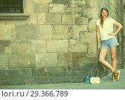 Купить «Romantic girl with stone wall background», фото № 29366789, снято 15 августа 2017 г. (c) Яков Филимонов / Фотобанк Лори
