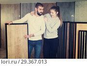 Купить «couple looking laminated flooring», фото № 29367013, снято 2 февраля 2018 г. (c) Яков Филимонов / Фотобанк Лори