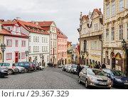 Nerudova street in the Prague district of Mala Strana.  Czech Republic (2018 год). Редакционное фото, фотограф Николай Коржов / Фотобанк Лори