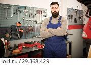 Купить «Multi-ethnic guy is showing his workplace», фото № 29368429, снято 14 ноября 2018 г. (c) Яков Филимонов / Фотобанк Лори