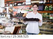Купить «Seller offering tray of cakes», фото № 29368525, снято 24 января 2017 г. (c) Яков Филимонов / Фотобанк Лори