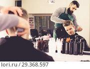 Купить «client feeling discontent about his new haircut at hair salon», фото № 29368597, снято 27 января 2017 г. (c) Яков Филимонов / Фотобанк Лори