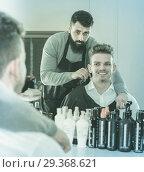 Купить «Male hairdresser preparing client for haircut», фото № 29368621, снято 27 января 2017 г. (c) Яков Филимонов / Фотобанк Лори