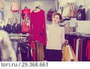 Купить «Girl choosing colorful blouse», фото № 29368661, снято 7 февраля 2017 г. (c) Яков Филимонов / Фотобанк Лори