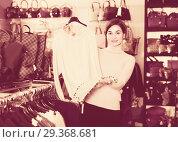 Купить «Female is deciding on warm sweater», фото № 29368681, снято 7 февраля 2017 г. (c) Яков Филимонов / Фотобанк Лори