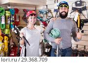 Купить «Young couple choosing alpinism equipment in store», фото № 29368709, снято 24 февраля 2017 г. (c) Яков Филимонов / Фотобанк Лори