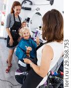 Купить «Hairdressers finished haircut for senior woman», фото № 29368753, снято 26 июня 2018 г. (c) Яков Филимонов / Фотобанк Лори