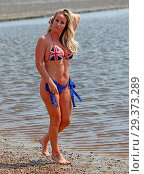 Купить «Reality Star Danielle Mason wearing her patriotic Union Jack bikini on Chalkwell Beach, Essex earlier today. Featuring: Danielle Mason Where: Chalkwell...», фото № 29373289, снято 21 мая 2018 г. (c) age Fotostock / Фотобанк Лори