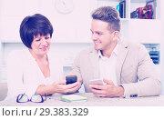 Купить «Mother and son with smartphones», фото № 29383329, снято 8 июля 2020 г. (c) Яков Филимонов / Фотобанк Лори