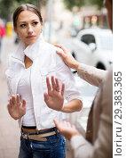 Купить «Boring male person accosting to young female», фото № 29383365, снято 27 февраля 2020 г. (c) Яков Филимонов / Фотобанк Лори