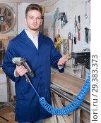 Купить «Joiner practising his skills with milling cutter», фото № 29383373, снято 7 ноября 2016 г. (c) Яков Филимонов / Фотобанк Лори