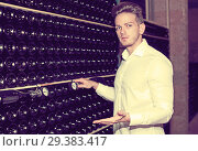 Купить «Male worker checking secondary fermentation of wine», фото № 29383417, снято 10 ноября 2016 г. (c) Яков Филимонов / Фотобанк Лори