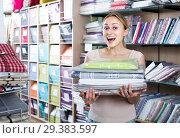 Купить «portrait of female customer choosing tablecloths in home textile section in shop», фото № 29383597, снято 22 марта 2019 г. (c) Яков Филимонов / Фотобанк Лори