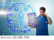 Купить «Doctor looking at x-ray image in telehealth concept», фото № 29385105, снято 26 марта 2019 г. (c) Elnur / Фотобанк Лори