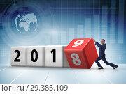 Купить «Businessman employee rotating cube to reveal number 2019», фото № 29385109, снято 23 мая 2019 г. (c) Elnur / Фотобанк Лори