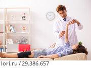 Купить «Male doctor checking joint flexibility with goniometer», фото № 29386657, снято 24 августа 2018 г. (c) Elnur / Фотобанк Лори