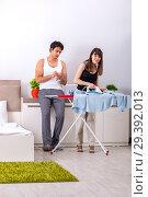 Купить «Young woman doing ironing for her husband», фото № 29392013, снято 27 июня 2018 г. (c) Elnur / Фотобанк Лори