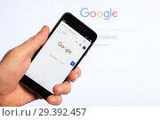 Купить «Adygea, Russia - January 4, 2018: the home page of popular web site the American search engine Google on the screen of the Chinese Xiaomi smart phone in male hand», фото № 29392457, снято 4 января 2018 г. (c) Андрей С / Фотобанк Лори