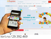 Купить «Adygea, Russia - January 5, 2018: AliExpress global marketplace with products from manufacturers from China on the screen of a smart phone and Xiaomi on the computer monitor», фото № 29392469, снято 5 января 2018 г. (c) Андрей С / Фотобанк Лори