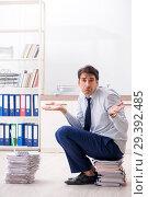 Купить «Extremely busy employee working in the office», фото № 29392485, снято 31 июля 2018 г. (c) Elnur / Фотобанк Лори